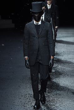 76c073b0f83 Thom Browne Menswear Autumn   Winter 2015 presented a dark noire suited  collection during Paris Fashion Week.