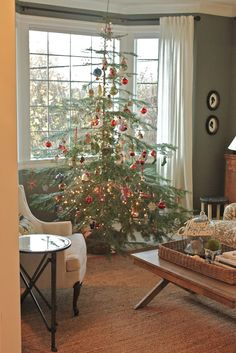 in all her Charlie Brown tree goodness. If it were up to me we would always have a natural tree. I have collecte. Christmas Tree Themes, Holiday Tree, Country Christmas, Simple Christmas, All Things Christmas, Vintage Christmas, Christmas Holidays, Holiday Decor, Merry Christmas