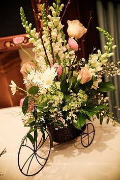 Grapevine Flowers Wedding, Country Chic, centerpiece with bicycle.