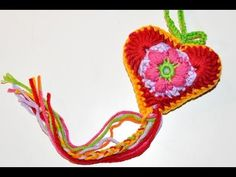 http://www.knitaholics.com/ * This little crochet flower already was center of our crochet star a few days ago. Today's video teaches you, how to crochet a heart around...