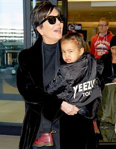 North West was photographed sporting her rapper father's signature scowl at London's Heathrow Airport over the weekend.