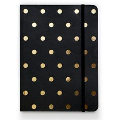Our Polka Dot Journal in black is covered in gold foil polka dots and kept closed with a black elastic band. 75 lined pages inside. dimensions: 8 x 6 inches Made by Sugar Paper L.A.