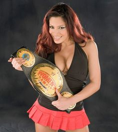 See Photos Of Every Diva To Hold The Wwe Womens Championship Including Trish Stratus Lita And Stephanie Mcmahon