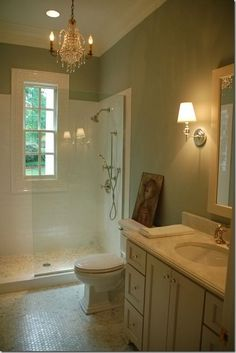 I like the soft garden green wall with tan/beige cabinetry. White ceiling. Elegant and comfy.