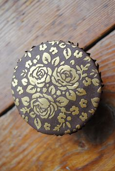 The perfect way to add a touch of vintage glamour to your cupcakes. This rose design has been created using our cake stencil with gold lustre powder. Stencils available to purchase from www.cakecrafting.co.uk.