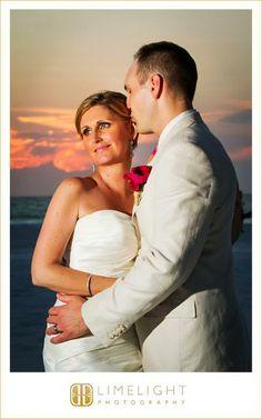 Hyatt Regency Clearwater Beach, Groom, Wedding, Portrait, Pink flower, Bride, Sunset, Limelight Photography, www.stepintothelimelight.com