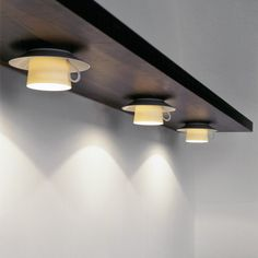 The Coffee Lights are very humorous and give the shades a soft glow while offering the practicality of task lighting in the kitchen. Designed by Anthology Quartett