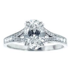 Oval Diamond Ring | From a unique collection of vintage engagement rings at http://www.1stdibs.com/jewelry/rings/engagement-rings/