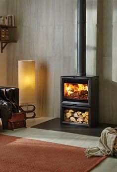 Increasing the vertical presence of these large format wood burning and multi-fuel stoves, the Stovax View 8 Midline features an integral log store that el
