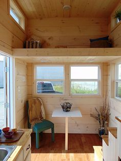 green-living-incredible-tiny-house-009.My preference would be for a sofa and pull up table.