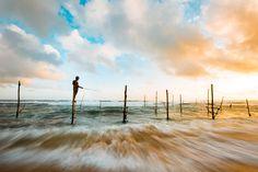 Stilt Fisherman in Sri Lanka. #WanderlustLama #SriLankaTravel #StiltFisherman #Adventure #Travel #SriLankaDestinations #SriLankaPointsofInterest #SriLankaHotels #SriLankaBeaches #SriLankaWeather #SriLankaHolidays #SriLankaAir