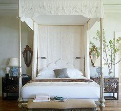 Symmetry is always a safe bet when buying pieces to go on either side of the bed, so double up.The bedroom is an ideal place to use treasured textiles, whether hanging behind the bed or stitched into a custom canopy Add easy-to-reach task lighting in addition to table lamps Decorative mirrors can bring just as much visual interest to your walls as art A white headboard combined with white bedding looks great, and together they equal an oasis of calm.