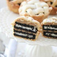 http://picky-palate.com/2011/07/13/oreo-and-peanut-butter-layered-baby-lattice-pies/