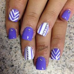 Blue violet themed nail art design. White polish is also used for base color and details with transparent beads on top.
