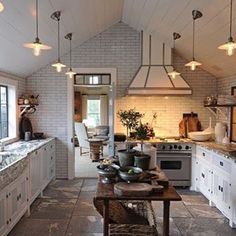 This is a kitchen I obsess over!  I just adore everything about it. The  ceiling, the tiles, the lights, the range hood.... Then there's the rustic table laden with goodies - chunky cutting boards and pot plants, down to the collection of vintage pottery in the corner!  Thanks to @stevengambrel for the  inspiration.  Recreate this look with our exquisite collection of French furniture and homewares.  #stevengambrel #kitchen #dreamkitchen #rustictable #vintagefinds #modernfarmhouse…
