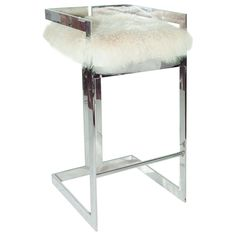 """The Worlds Away Hearst barstool presents linear intrigue to contemporary spaces. Accented by a texturally alluring off-white fur cushion, this metallic seat gleams in a striking nickel finish. Minimum purchase of 2; Natural Mongolian fur cushion; 18""""W x 18""""D x 34""""H; Seat: 17""""W x 17.75""""D x 30""""H; Foor rest from ground: 9.5""""H"""