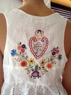 Folk Embroidery Ideas Magyar (hungarian) inspired - the center heart symbol is what defines a lot of the center motif of the sacred folk costumes of the Magyar's women embroidery Mexican Embroidery, Folk Embroidery, Embroidery Dress, Cross Stitch Embroidery, Embroidery Patterns, Bordado Popular, Couture Main, Folk Fashion, Embroidered Clothes