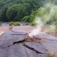 Centralia, PA fire is still burning underground. I have my pic as a child on this stretch of road; Used to be able to drive on it. Abandoned Buildings, Abandoned Places, Centralia Pennsylvania, Dark Places, Haunted Places, Ghost Towns, After Dark, Natural Disasters, Small Towns