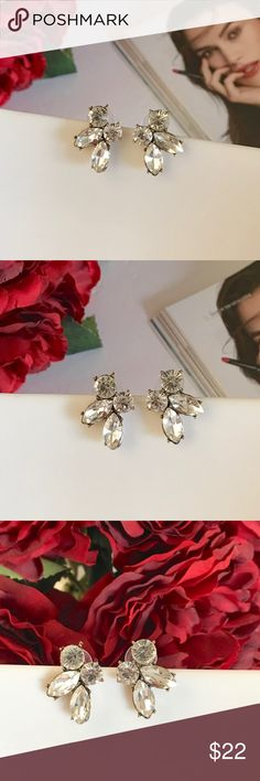 Elegant Clear Crystal Like Rhinestone Earrings Brand New Boutique Item   Classy crystal like clear rhinestone stud earrings. Very unique design and stylish for any elegant lady. Sparkling and sophisticated earrings are perfect addition to your elegant outfit. With a dainty floral design. These luxurious jewel statement earrings are both classy and elegant. Clear crystal rhinestone gems set in antique gold colored zinc alloy. They are stud earrings with push backs. Size: 2.6 cm x 2 cm. Marina…