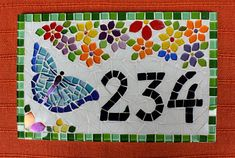 House number with flowers and butterfly