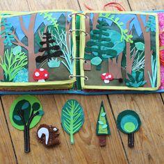 Quiet Book mamá extraterrestre libro actividades tela texturas bebé toddler bosque arboles ardilla