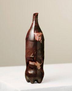 Per Johansen's Grotesque Photographs Of Meat Stuffed Into Bottles