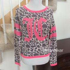 """Juicy Couture Snow Leopard Sweater NWT  On trend varsity sweater styling on a gray snow leopard print with silver metallic threads. Pink bands on the sleeve, hemline and neckline  63% cotton; 20% acrylic; 6% metallic  bust 44""""; hip 40""""; length 24"""". Has stretch  NWT no damage or flaws. Smoke free home  I also have this listed in a size XS  Juicy Couture Sweaters Crew & Scoop Necks"""