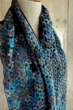 A moody blue palette of cushy blooms, 12 x 52 inches, hand crocheted merinos wool.