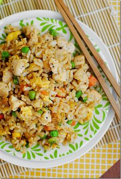 Chicken Fried Rice - Easy and Filling Family Meal.2 cups prepared rice (I used long grain brown rice)   1 chicken breast, cut into bite-sized pieces and seasoned with salt & pepper (could use leftover cooked chicken)   1/2 cup frozen mixed vegetables   2 green onions, chopped   1 clove garlic, minced   1 egg   3 teaspoons sesame or wok oil, divided   2 Tablespoons soy sauce