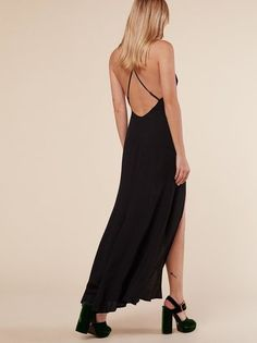 Fine, I'll go out. This is an ankle length dress with a high slit and adjustable, cross-back straps.