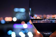Love the colors and the wine glass in the foreground...of course more Bokeh.