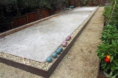 backyard bocce ball courts bocce court is made of redwood steel and gravel this bocce court has a Backyard Sports, Backyard Games, Backyard Projects, Outdoor Projects, Backyard Landscaping, Outdoor Ideas, Backyard Ideas, Backyard Parties, Outdoor Parties