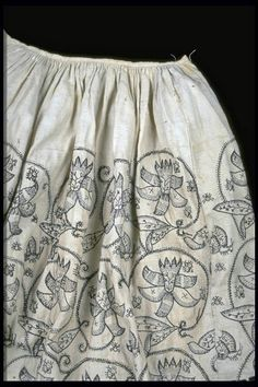 A rare woman's skirt made from fustian, a mix of linen and cotton, and embroidered with large floral patterns. Production Date: 1621-1640.  | Museum of London