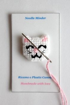 Needle minder cat, needlework, cross stitch needle, kawaii cat, needleminders, needlecrafts, cat lovers, embroidery needle, cat magnet, gifts Cat needle minder entirely handmade by me with plastic canvas and acrylic yarn. This cute needleminder is perfect for embroidery, cross