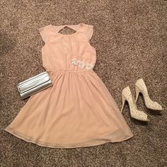 Gorgeous blush dress! Such a cute, feminine dress! Beautiful blush color with beading detail on the cap sleeves. The back features a button closure with a flirty cut-out back. Bracelet featured in this post is also for sale. See other listings! Forever 21 Dresses