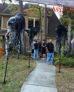 Kingwood Asylum Scarecrows - When the guys over at the Kingwood Asylum set out to build some scarecrows they had two real objectives in mind.  The first was to make something wickedly evil looking, while the second was not to spend a lot of money completing objective number one.  I would say their objectives were met with success.  These scarecrows are amazing looking, and judging from their parts list, didn't cost too much per unit.