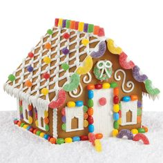 This easy gingerbread design evokes visions of holiday splendor. Lovely lattice tops the roof and bright candies. Everything you need is included in our Gingerbread House Kit.