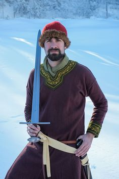 12th century lower noble with one handed sword with basilnut pommel. Comthurey Alpinum Living history Reenactment Switzerland