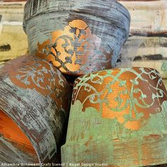 Aged Stencil Patina Flower Pots created with Royal Design Studio Stencils and Modern Masters Metal Effects Patina.