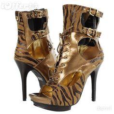 http://cdn3.iofferphoto.com/img/item/189/220/286/womens-brown-tiger-print-heels-boots-size-5-5-10-3cc06.jpg