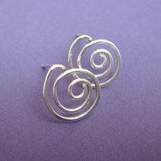 Sterling Silver Swirl Post Earrings- Sterling silver wire is hand formed into modern, organic swirl designs. These post earrings are simple, fun, and lightweight. Ive hammered and tumbled them for strength and shine. Earrings are approximately 1.2 cm long and 1.1 cm wide. Because I make the