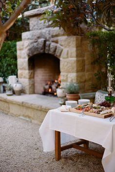An al fresco ambience is so soothing and pleasant. The days troubles melt away as you relax with friends by the fire. Outdoor Life, Outdoor Dining, Outdoor Gardens, San Ysidro Ranch, Appetizers Table, Table Set Up, Cheese Platters, Beautiful Inside And Out, Al Fresco Dining