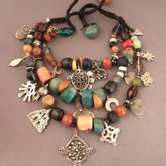 Africa | An old necklace from the Draa Valley in South Morocco | Old coin, different silver pendants, amber, amazonite, coral, shell, glasspasta | ca. 100 years old.