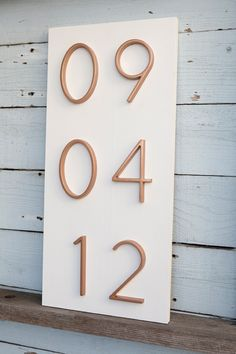 Wedding Gifts I'm obsessing over this DIY address number wedding date sign! - Learn how to make a stunning wedding date sign using address numbers from the hardware store! Easy to customize and would make a fabulous gift! Wedding Date Sign, Wedding List, Wedding Signage, Reception Signs, Wedding Table Decorations, Wedding Table Numbers, Address Numbers, Diy Wedding Projects, Wedding Keepsakes