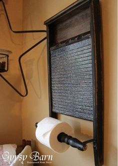 Photo: Another fun idea for a unique piece in the bathroom.  a great DIY piece! Washboard, Spindle, curtain rod holders. :D Fun and easy.