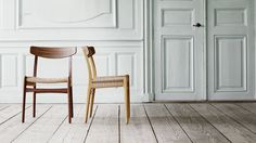 """Hans J Wegner's famous """"Wishbone"""" chair has been reunited with its former companion, the CH23, which Carl Hansen & Son is putting back into production."""