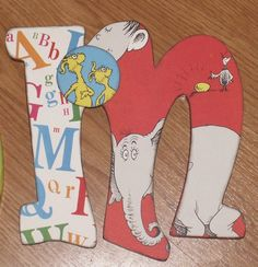 I love this idea...Dr. Seuss letters with the story book pictures