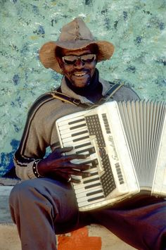 Photograph Accordion player, South Africa, photo by Marnix Van Marcke on 500px
