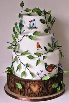 'birds with hats' wedding cake  by Happyhills Cakes - http://cakesdecor.com/cakes/205943-birds-with-hats-wedding-cake