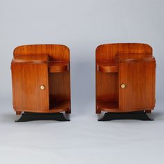 Pair Art Deco Side Cabinets with Ebonised Base  --  This pair of circa 1930s French Art Deco side cabinets could be used to flank a sofa or as night stands.  Each has a storage compartment with hinged door, and narrow open shelves at the sides. Cabinets are set on ebonised trestle foot at the front. Sold and priced as a pair.  --   Item:  7501  --  Retail Price:   $3295